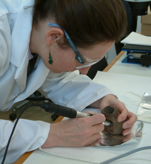 Alex taking a sample for radiocarbon dating (© Historic England)