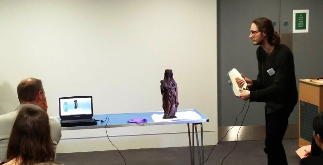 Image of Jonathan Beck using a structure light scanner to produce a 3D model of a medieval sculpture. Copyright The Fitzwilliam Museum, Cambridge.
